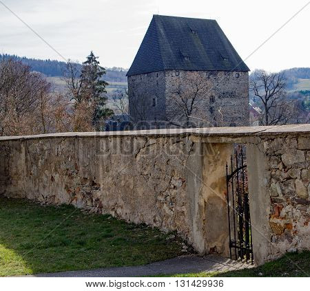 Wall in front of a medieval tower in Siedlecin in Silesia, Poland
