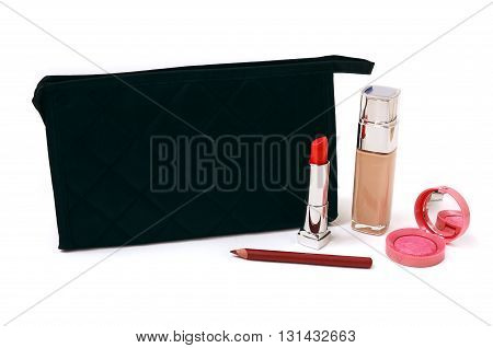 Cosmetics bag and makeup on a white background