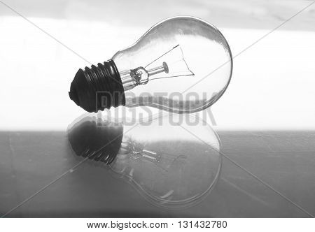 transparent light bulb with reflection on the glass