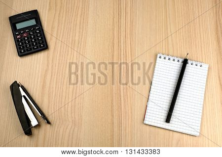 Tax calculation. Family budget. Calculator, notepad, pencil, stapler