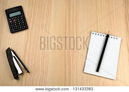 Tax calculation. Family budget. Calculator, notepad, pencil, stapler