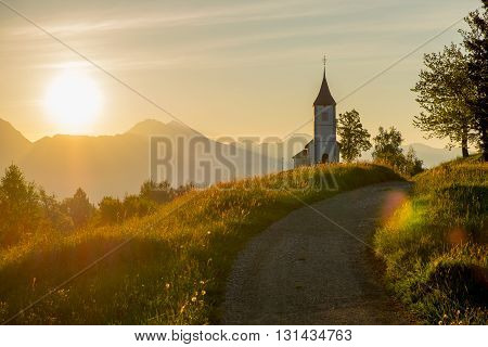 Catholic Church of Saints Primus and Felician, on the Hill at Sunrise in Jamnik, Slovenia