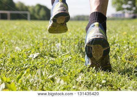Feet In Running Shoes, Closeup