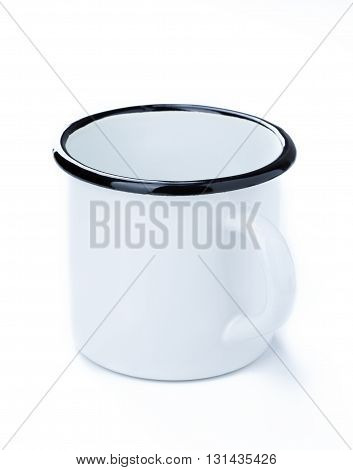 White enamel tin cup isolated on white background.