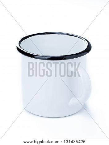 White enamel tin cup isolated on white background.