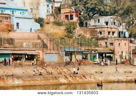 MADHYA PRADESH, INDIA - DEC 27, 2015: Cityscape of ancient river ghat and rustic indian houses of Chitrakoot on December 27, 2015 in India. Population of Chitrakoot is 22294 people