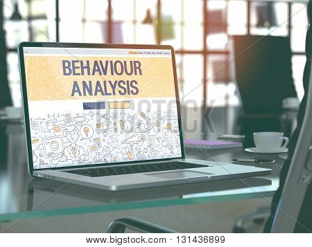 Modern Workplace with Laptop Showing Landing Page in Doodle Design Style with Text Behaviour Analysis. Toned Image with Selective Focus. 3D Render.