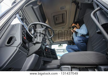 KIEV,UKRAINE - May,21: Photographer takes pictures of the interior of truck cabine during celebration of 125 anniversary of Scania company in Kiev,Ukraine May 21,2016.