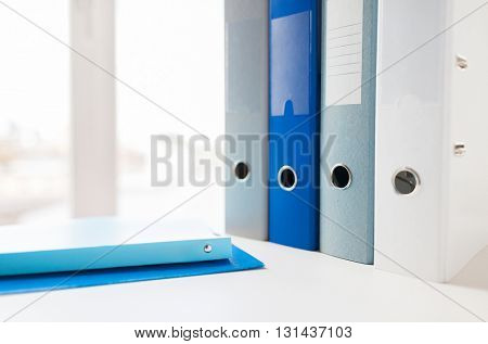 business, document, paperwork, office supply and education concept - close up of ring binders and files on table