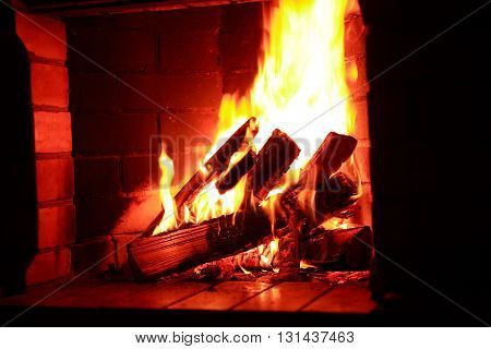 Flame background indoor. Firewood burning in fireplace