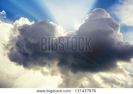 Dark cloudy sky with sun ray. Symbol of changes. Background. Good weather after storm