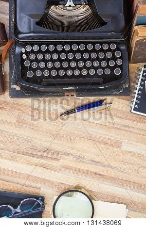 antique black vintage typewriter on working table with copy space, top view