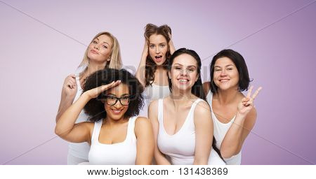 friendship, beauty, body positive and people concept - group of happy plus size women in white underwear having fun and making faces over violet background