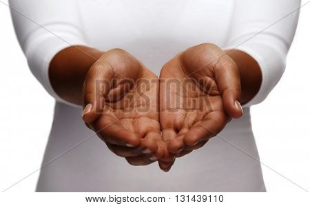 people, charity and poverty concept - close up of african american female empty cupped hands holding and showing something