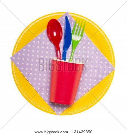Set brightest disposable tableware: plates, glasses, spoon, fork, knife, glass and napkin isolated on a white background.