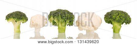 Broccoli and cauliflower close up isolated on white background.