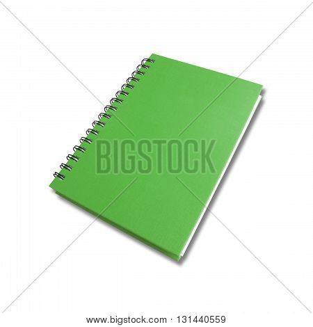 Green note book on white color background