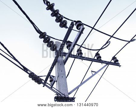 electricity post infrastructure structure against clear blue sky