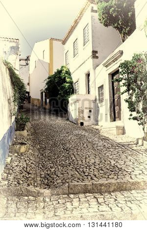 Narrow Street in the Medieval Portuguese City of Obidos Retro Image Filtered Style
