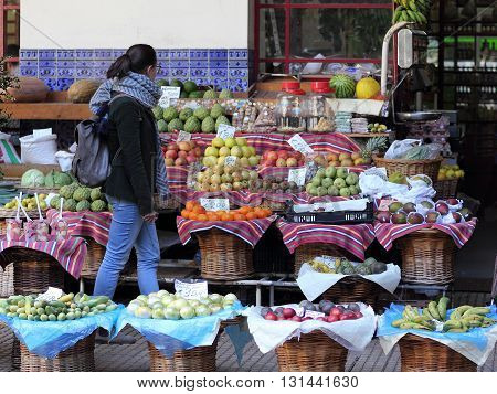 FUNCHAL ISLAND OF MADEIRA PORTUGAL - 2016 APRIL Fruit stall in the Farmers market in Funchal on Madeira. Agriculture and tourism are the most important economic factors on the Atlantic island.