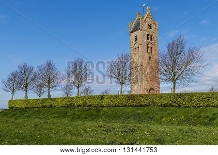 Firdgum The Netherlands - April 18 2016: Church tower of the small city of Firdgum in Friesland in the Netherlands early spring.