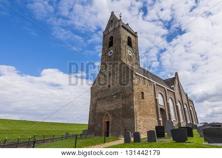 Wierum The Netherlands - April 18 2016: Church tower of the small city of Wierum in Friesland in the Netherlands.