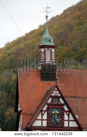 BAD URACH, GERMANY - OCTOBER 21: Rathouse with clock on the Marktplatz square in Bad Urach, Germany on October 21, 2014.