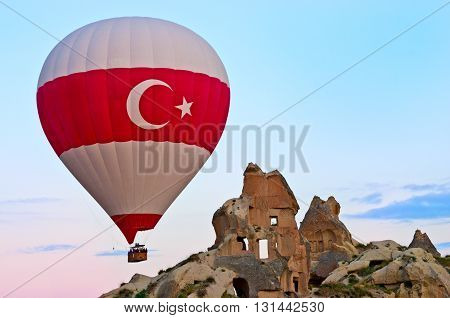 Hot air balloons over mountain landscape in Cappadocia Goreme National Park Turkey. Aerial view from air balloon