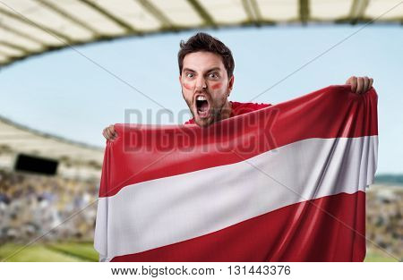 Fan holding the flag of Austria