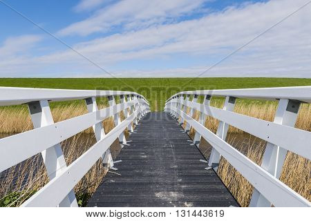 White wooden hikers and bicycle bridge in Friesland in the Netherlands.