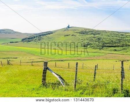 Landscape of East Sussex England. Pasture and The Belle Tout lighthouse as background. Near Eastbourne, East Sussex, England