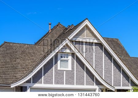 The top of the house or apartment building with nice window.