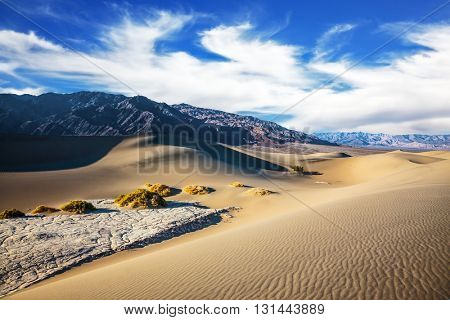 Hot and windy morning in the desert. Gentle ripples on sand dunes. Hot autumn in Death Valley, California
