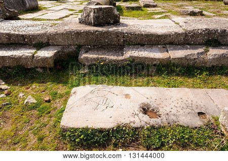 KRINIDES GREECE - FEBRUARY 25 2010: Christian symbol or children's games inscribed on marble ruins at Philippi