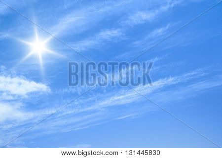 An image of a blue sky and sun background