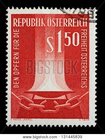 ZAGREB, CROATIA - SEPTEMBER 09: stamp printed by Austria, shows Flame and broken chain, circa 1961, on September 09, 2014, Zagreb, Croatia