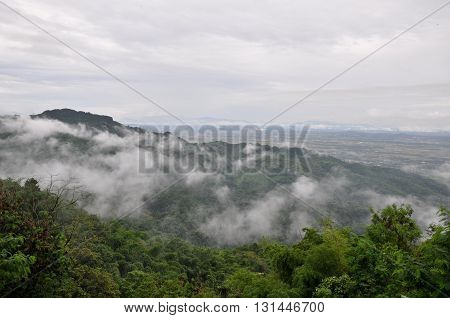 landscape of green mountain with haze cloud