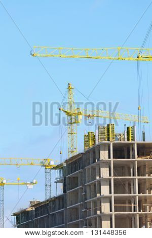 Cranes on the construction of high-rise buildings