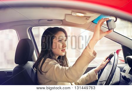 Girl driving in the city