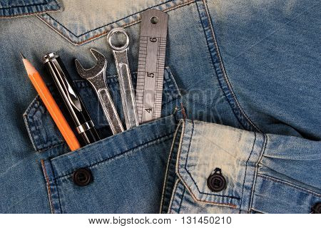 Wrench Tools On A Denim Workers Pocket, A Jeans Pocket With Tools.