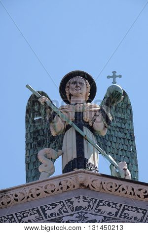 LUCCA, ITALY - JUNE 06, 2015: Saint Michael on the top of the San Michele in Foro Church in Lucca, Italy, on June 06, 2015
