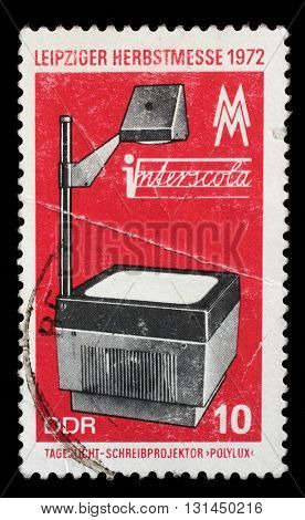 ZAGREB, CROATIA - SEPTEMBER 09: a stamp printed in GDR shows overhead projector, Leipzig Autumn Fair, circa 1972, on September 09, 2014, Zagreb, Croatia