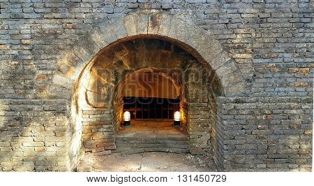 Old underground brick tunnel with lamps in Thai temple wat umong chiang mai thailand