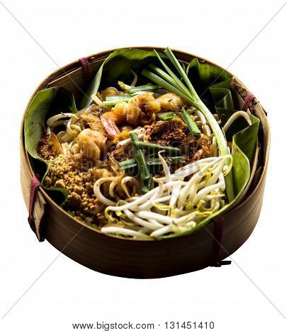 Thai style noodles or padthai isolated on white background Delicious food on the banana lea