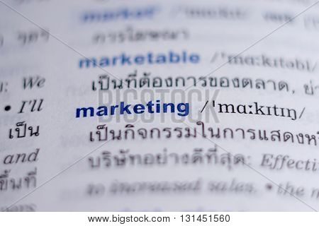 Dictionary page with word marketing highlight in blue