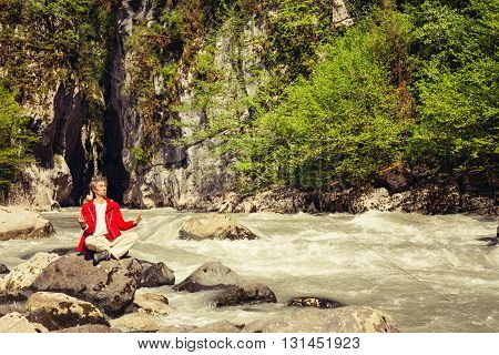 Cheerful Man Relaxing Outdoor On A Background Of A Mountain River. Travel Lifestyle Concept.