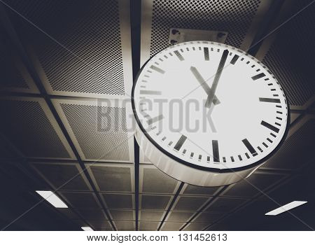 Half tone color filter effect, Public clock in railway station, Concept image