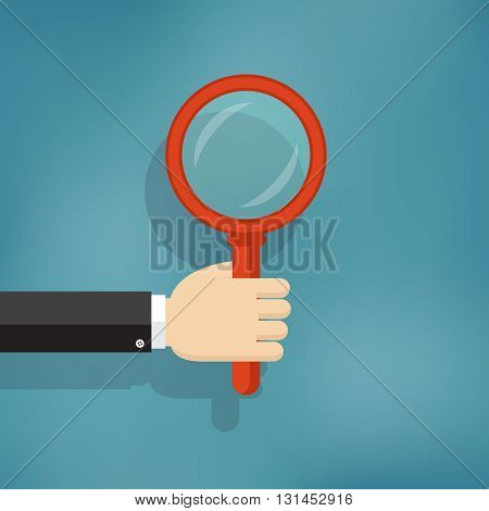 Illustration of hand holding magnifying glass in flat style.