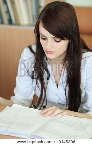 Medical theme: doctor is studying a medical report.