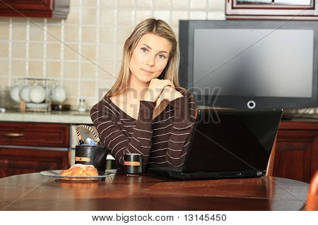 Young woman with her laptop at home.